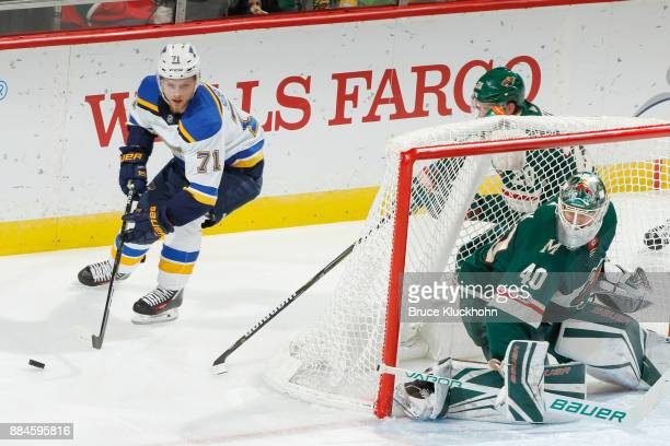 Ryan Suter and goalie Devan Dubnyk of the Minnesota Wild defend their goal against Vladimir Sobotka of the St Louis Blues during the game at the Xcel...