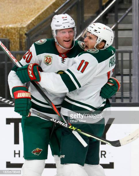 Ryan Suter and Zach Parise of the Minnesota Wild celebrate after Suter assisted Parise on a first-period goal against the Vegas Golden Knights in...