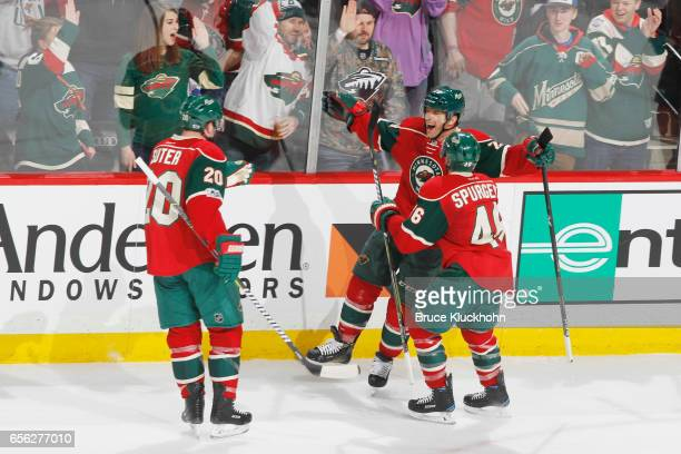 Ryan Suter Jason Pominville and Jared Spurgeon of the Minnesota Wild celebrate after scoring a goal against the San Jose Sharks during the game on...