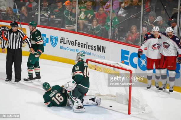 Ryan Suter Jason Zucker and Devan Dubnyk of the Minnesota Wild plead their case with Referee Tom Kowal as Alexander Wennberg celebrates with his...