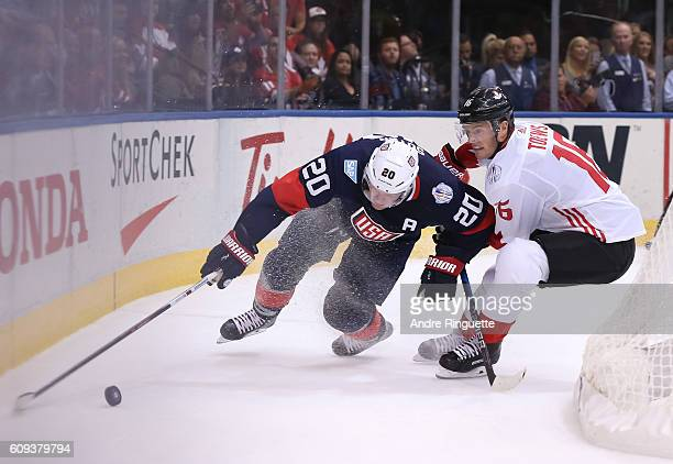 Ryan Suter of Team USA collides with Jonathan Toews of Team Canada during the World Cup of Hockey 2016 at Air Canada Centre on September 20 2016 in...