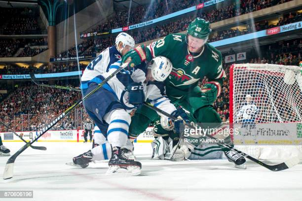 Ryan Suter of the Minnesota Wild and Kyle Connor of the Winnipeg Jets battle for the puck during the game at the Xcel Energy Center on October 31...