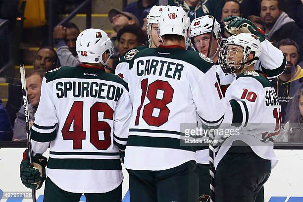 Ryan Suter of the Minnesota Wild celebrates with Jordan Schroeder Ryan Carter and Jared Spurgeon after scoring a goal against the Boston Bruins...
