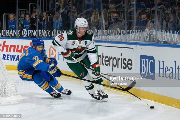 Ryan Suter of the Minnesota Wild controls the puck as Vladimir Tarasenko of the St. Louis Blues pressures on April 10, 2021 at the Enterprise Center...