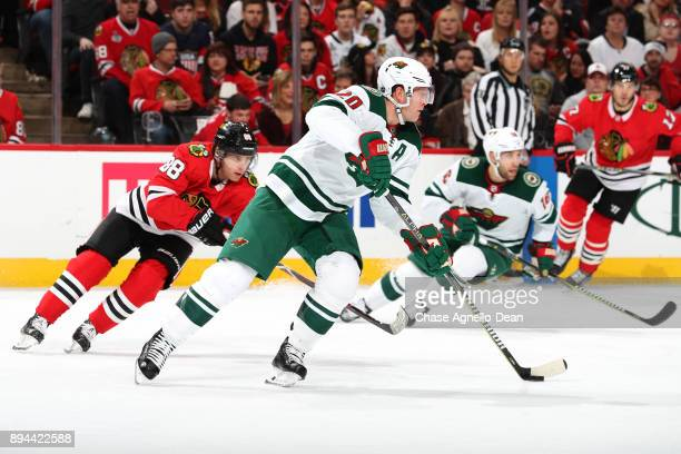 Ryan Suter of the Minnesota Wild controls the puck next to Patrick Kane of the Chicago Blackhawks in the second period at the United Center on...