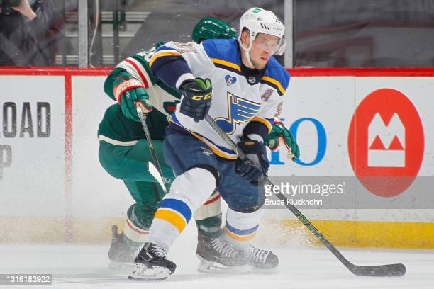 Ryan Suter of the Minnesota Wild defends Vladimir Tarasenko of the St. Louis Blues during the game at the Xcel Energy Center on April 28, 2021 in...