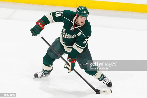 Ryan Suter of the Minnesota Wild handles the puck against the Chicago Blackhawks in Game Four of the Western Conference Quarterfinals during the 2013...
