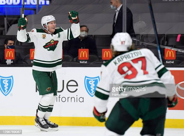 Ryan Suter of the Minnesota Wild reacts to his goal in front of Kirill Kaprizov, to tie the score 3-3 with the Los Angeles Kings, during a 4-3...