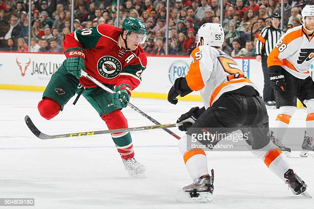 Ryan Suter of the Minnesota Wild shoots the puck with Nick Schultz of the Philadelphia Flyers defending during the game on January 7, 2016 at the...