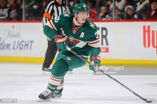 Ryan Suter of the Minnesota Wild skates with the puck against the San Jose Sharks during the game at the Xcel Energy Center on February 25 2018 in St...