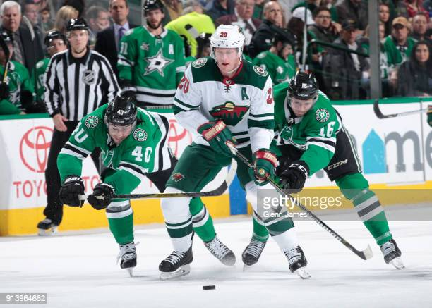 Ryan Suter of the Minnesota Wild tries to keep the puck away against Remi Elie and Jason Dickinson of the Dallas Stars at the American Airlines...