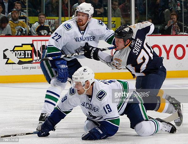 Ryan Suter of the Nashville Predators fires the puck against Daniel Sedin and Markus Naslund of the Vancouver Canucks on February 21 2008 at the...