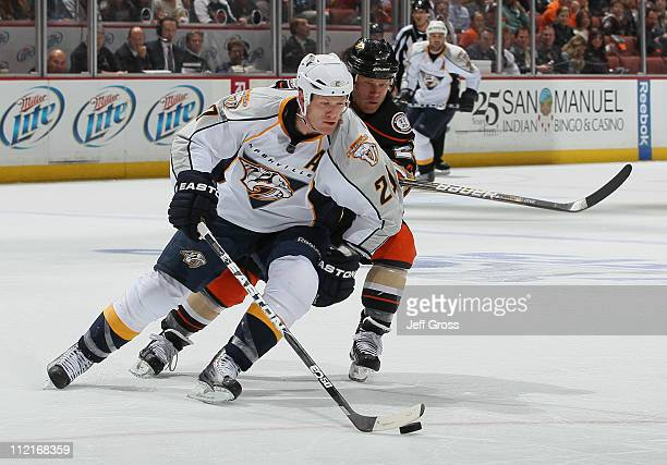 Ryan Suter of the Nashville Predators is pursued by Todd Marchant of the Anaheim Ducks for the puck in the third period of Game One of the Western...