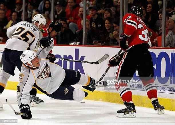 Ryan Suter of the Nashville Predators slips and falls while battling for the puck with Kris Versteeg of the Chicago Blackhawks in Game One of the...