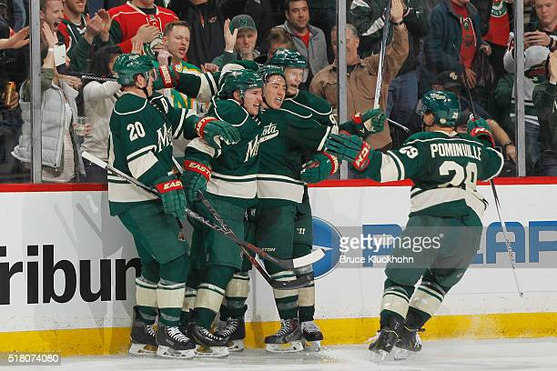 Ryan Suter Zach Parise Jared Spurgeon Mikko Koivu and Jason Pominville of the Minnesota Wild celebrate after scoring a goal against the Chicago...