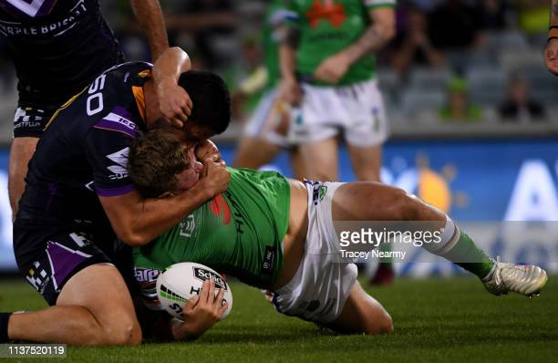 Ryan Sutton of the Canberra Raiders is tackled during the round two NRL match between the Canberra Raiders and the Melbourne Storm at GIO Stadium on...