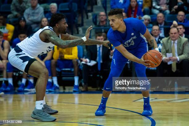 Ryan Swan of the Air Force Falcons looks for an open teammate past Jordan Caroline of the Nevada Wolf Pack during the second half at Clune Arena on...