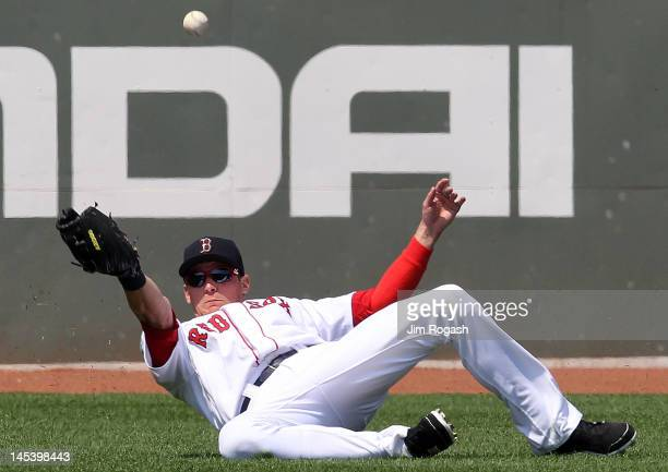 Ryan Sweeney of the Boston Red Sox misplays a ball against the Detroit Tigers in the second inning at Fenway Park May 28 2012 in Boston Massachusetts
