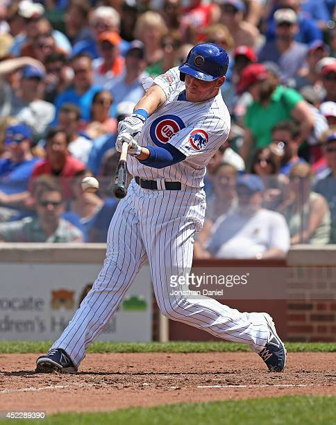 Ryan Sweeney of the Chicago Cubs bats against the Washington Nationals at Wrigley Field on June 28 2014 in Chicago Illinois The Nationals defeated...