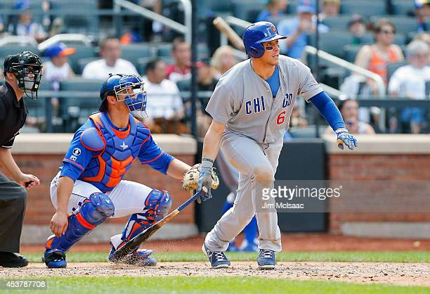 Ryan Sweeney of the Chicago Cubs follows through on an eighth inning base hit against the New York Mets at Citi Field on August 17 2014 in the...