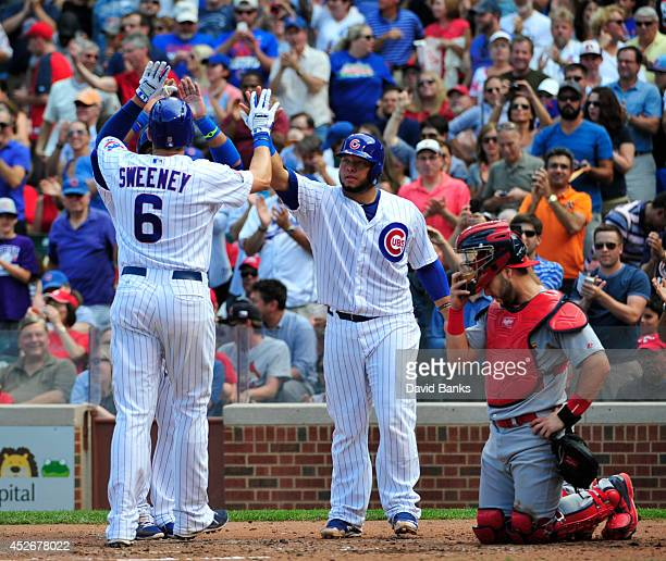 Ryan Sweeney of the Chicago Cubs is greeted by Welington Castillo after hitting a threerun homer against the St Louis Cardinals during the second...