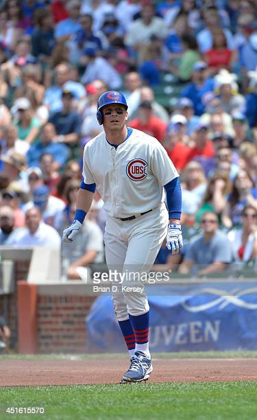 Ryan Sweeney of the Chicago Cubs leads off first base during the first inning against the Pittsburgh Pirates at Wrigley Field on June 22 2014 in...