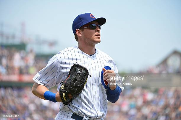 Ryan Sweeney of the Chicago Cubs runs off the field against the New York Mets on May 19 2013 at Wrigley Field in Chicago Illinois The Mets defeated...