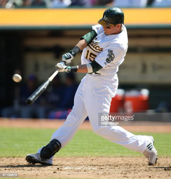 Ryan Sweeney of the Oakland Athletics bats against the Texas Rangers during the game at the OaklandAlameda County Coliseum on September 24 2009 in...