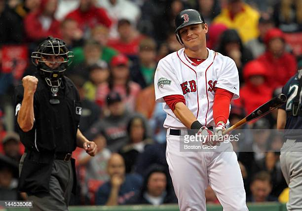 Ryan Sweeney strikes out in the sixth inning as the Boston Red Sox play the Seattle Mariners at Fenway Park