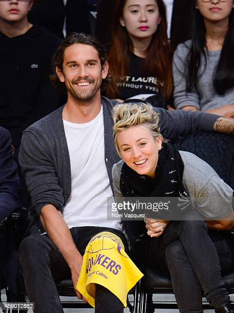 Ryan Sweeting and Kaley Cuoco attend a basketball game between the San Antonio Spurs and the Los Angeles Lakers at Staples Center on November 14,...