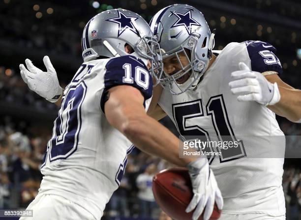 Ryan Switzer an 83yard touchdown punt return with Kyle Wilber against the Washington Redskins in the second quarter at ATT Stadium on November 30...