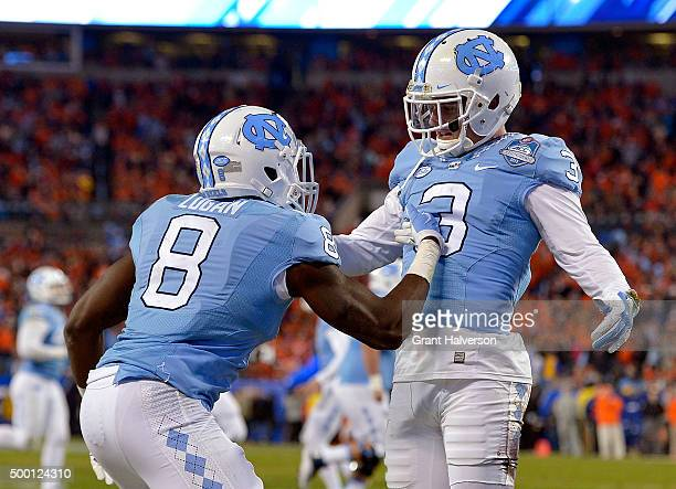 Ryan Switzer celebrates with TJ Logan of the North Carolina Tar Heels after scoring a touchdown against the Clemson Tigers during the Atlantic Coast...