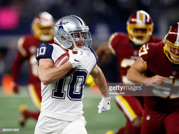 Ryan Switzer of the Dallas Cowboys carries the ball for an 83yard punt return touchdown in the second quarter against the Washington Redskins at ATT...