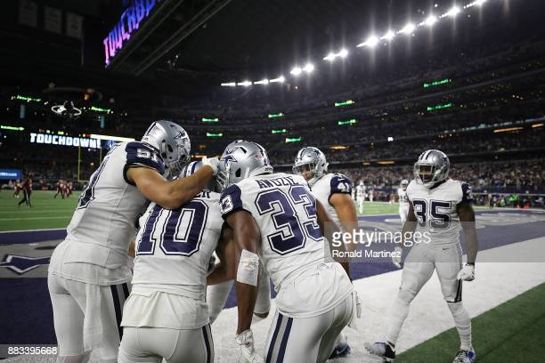 Ryan Switzer of the Dallas Cowboys celebrates his 83yard touchdown punt return against the Washington Redskins in the second quarter at ATT Stadium...