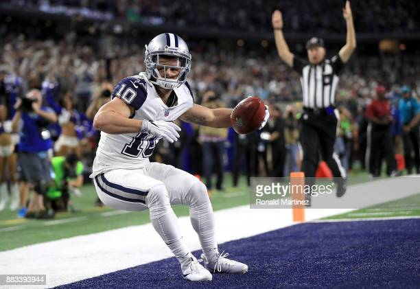Ryan Switzer of the Dallas Cowboys dives into the endzone on an 83yard touchdown punt return against the Washington Redskins in the second quarter at...