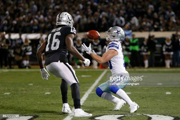 Ryan Switzer of the Dallas Cowboys makes a faircatch against the Oakland Raiders at OaklandAlameda County Coliseum on December 17 2017 in Oakland...