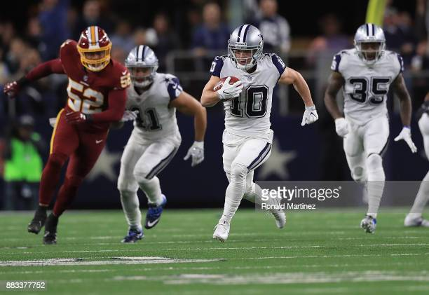 Ryan Switzer of the Dallas Cowboys runs for a 83yard touchdown punt return against the Washington Redskins in the second quarter at ATT Stadium on...