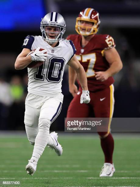Ryan Switzer of the Dallas Cowboys runs past Nick Sundberg of the Washington Redskins for a 83yard touchdown punt return against the Washington...