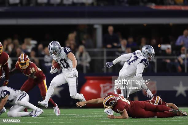 Ryan Switzer of the Dallas Cowboys runs past Tress Way of the Washington Redskins for a 83yard touchdown punt return against the Washington Redskins...