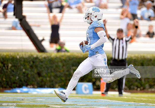 Ryan Switzer of the North Carolina Tar Heels scores a touchdown on a long pass play against the Illinois Fighting Illini during their game at Kenan...