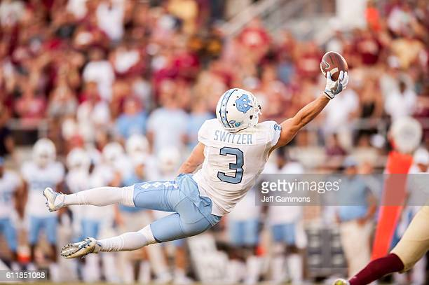 Ryan Switzer of the North Carolina Tar Heels stretches out in an attempt to make a catch against the Florida State Seminoles at Doak Campbell Stadium...