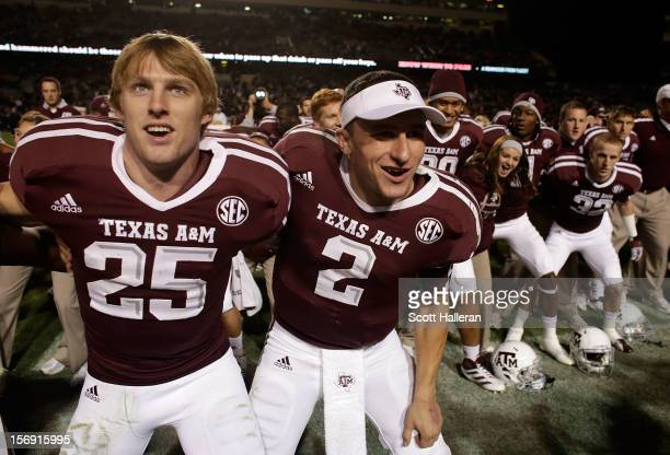 Ryan Swope and Johnny Manziel of the Texas A&M Aggies celebrate with teammates after defeating the Missouri Tigers 59-29 at Kyle Field on November...