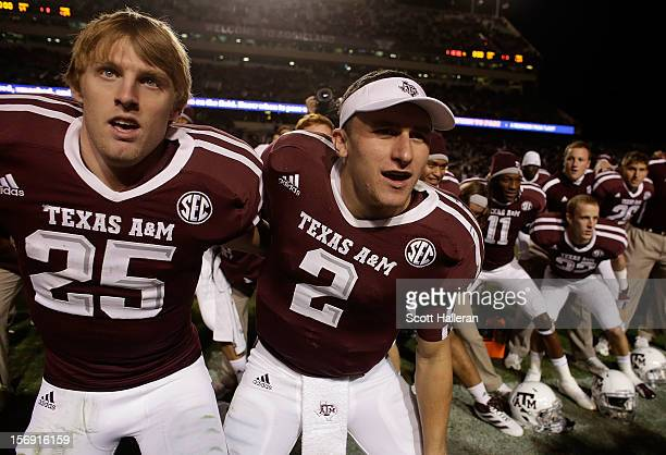 Ryan Swope and Johnny Manziel of the Texas AM Aggies celebrate with teammates after defeating the Missouri Tigers 5929 at Kyle Field on November 24...