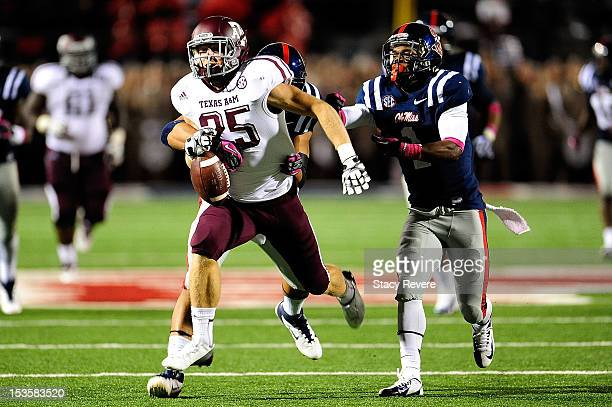Ryan Swope of the Texas AM Aggies is stripped of the ball by Cody Prewitt of the Ole Miss Rebels during a game at VaughtHemingway Stadium on October...