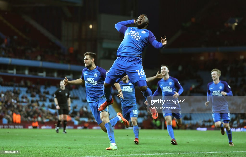 Ryan Tafazolli (5) celebrates after scoring the second goal with Junior Morias (16) during the The Emirates FA Cup Third Round match between Aston Villa and Peterborough United at Villa Park on January 6, 2018 in Birmingham, England.