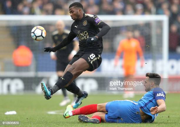 Ryan Tafazolli of Peterborough United tackles Kelechi Iheanacho of Leicester City during The Emirates FA Cup Fourth Round match between Peterborough...
