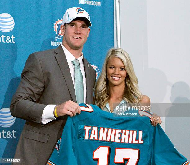 Ryan Tannehill and his wife Lauren hold his new Dolphins jersey after he was introduced to the media on April 28 2012 at the Miami Dolphins training...