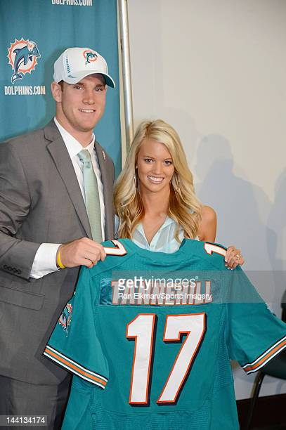 Ryan Tannehill and his wife Lauren Tannehill pose at a press conference at the Miami Dolphins training facility on April 28 2012 in Davie Florida...