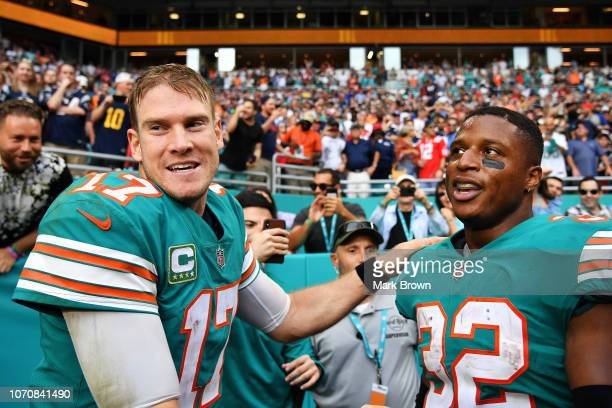 Ryan Tannehill and Kenyan Drake of the Miami Dolphins celebrate their 34 to 33 win over the the New England Patriots at Hard Rock Stadium on December...