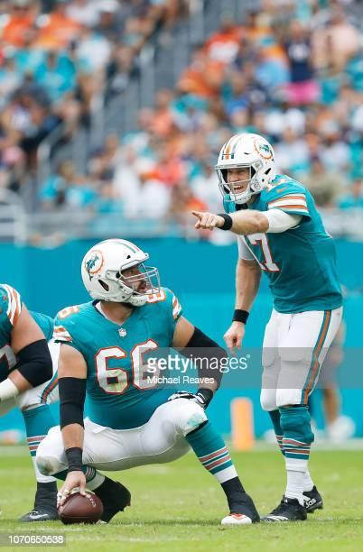 Ryan Tannehill calls a play as Travis Swanson of the Miami Dolphins looks on in the first half against the New England Patriots at Hard Rock Stadium...